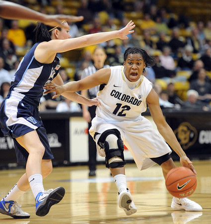 "Ashley Wilson of CU tries to get around Lauren Burford of Villanova<br /> during the first half of the March 22, 2012 game in Boulder. <br /> For more photos of the game, go to  <a href=""http://www.dailycamera.com"">http://www.dailycamera.com</a>.<br />  Cliff Grassmick / March 22, 2012"
