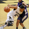 "Ashley Wilson of Colorado  drives past Justine Johnson of Weber State. <br /> For more photos of the game, go to  <a href=""http://www.dailycamera.com"">http://www.dailycamera.com</a>.<br /> December 17, 2011 / Cliff Grassmick"