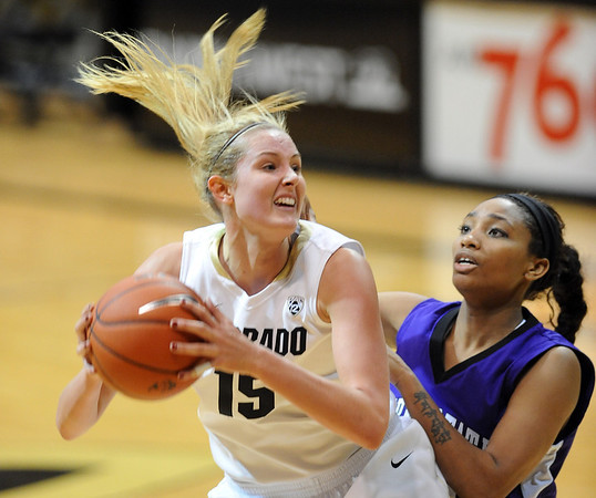 """Julie Seabrook of Colorado  turns to shoot on Shawnte Taylor of  Weber State on Saturday.<br /> For more photos of the game, go to  <a href=""""http://www.dailycamera.com"""">http://www.dailycamera.com</a>.<br /> December 17, 2011 / Cliff Grassmick"""