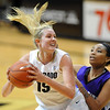 "Julie Seabrook of Colorado  turns to shoot on Shawnte Taylor of  Weber State on Saturday.<br /> For more photos of the game, go to  <a href=""http://www.dailycamera.com"">http://www.dailycamera.com</a>.<br /> December 17, 2011 / Cliff Grassmick"