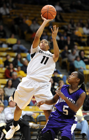 "Brittany Wilson of Colorado scores past Kia Rhodes of Weber State.<br /> For more photos of the game, go to  <a href=""http://www.dailycamera.com"">http://www.dailycamera.com</a>.<br /> December 17, 2011 / Cliff Grassmick"