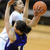"Chucky Jeffery of Colorado drives on Jordan Pfau of Weber State.<br /> For more photos of the game, go to  <a href=""http://www.dailycamera.com"">http://www.dailycamera.com</a>.<br /> December 17, 2011 / Cliff Grassmick"