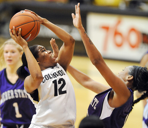 """Ashley Wilson of Colorado  goes up to score on Weber State.<br /> For more photos of the game, go to  <a href=""""http://www.dailycamera.com"""">http://www.dailycamera.com</a>.<br /> December 17, 2011 / Cliff Grassmick"""