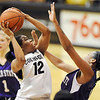 "Ashley Wilson of Colorado  goes up to score on Weber State.<br /> For more photos of the game, go to  <a href=""http://www.dailycamera.com"">http://www.dailycamera.com</a>.<br /> December 17, 2011 / Cliff Grassmick"