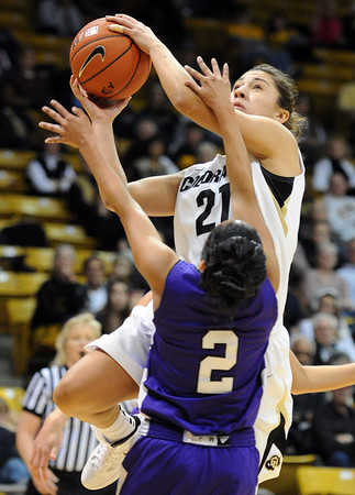 "Jasmine Sborov of Colorado drives on Justine Johnson of Weber State on Saturday.<br /> For more photos of the game, go to  <a href=""http://www.dailycamera.com"">http://www.dailycamera.com</a>.<br /> December 17, 2011 / Cliff Grassmick"