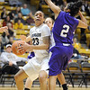 "Chucky Jeffery of Colorado drives on Justine Johnson of Weber State.<br /> For more photos of the game, go to  <a href=""http://www.dailycamera.com"">http://www.dailycamera.com</a>.<br /> December 17, 2011 / Cliff Grassmick"