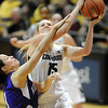 "Julie Seabrook  of Colorado is fouled by Megan Patterson of Weber State.<br /> For more photos of the game, go to  <a href=""http://www.dailycamera.com"">http://www.dailycamera.com</a>.<br /> December 17, 2011 / Cliff Grassmick"