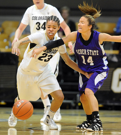 "Chucky Jeffery, left, of Colorado, and Caela Mohre of Weber State, go for a loose ball.<br /> For more photos of the game, go to  <a href=""http://www.dailycamera.com"">http://www.dailycamera.com</a>.<br /> December 17, 2011 / Cliff Grassmick"