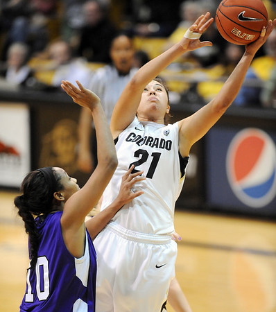 "Jasmine Sborov of Colorado drives on Shawnte Taylor of Weber State on Saturday.<br /> For more photos of the game, go to  <a href=""http://www.dailycamera.com"">http://www.dailycamera.com</a>.<br /> December 17, 2011 / Cliff Grassmick"