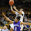 "Brittany Wilson of Colorado scores past Justine Johnson of Weber State.<br /> For more photos of the game, go to  <a href=""http://www.dailycamera.com"">http://www.dailycamera.com</a>.<br /> December 17, 2011 / Cliff Grassmick"