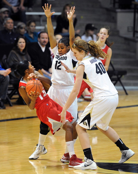 """Antiesha Brown of UNM id doubled by Ashley Wilson and Rachel Hargis, both of CU, during the first half of the December 29, 2012 game in Boulder.<br /> For more photos of the game, go to  <a href=""""http://www.dailycamera.com"""">http://www.dailycamera.com</a>.<br /> Cliff Grassmick / December 29, 2012"""