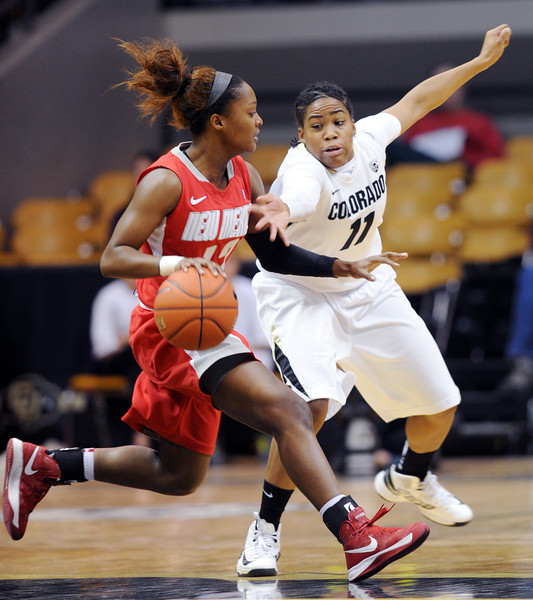 """Bryce Owens of UNM drives on Brittany Wilson of CU during the first half of the December 29, 2012 game in Boulder.<br /> For more photos of the game, go to  <a href=""""http://www.dailycamera.com"""">http://www.dailycamera.com</a>.<br /> Cliff Grassmick / December 29, 2012"""