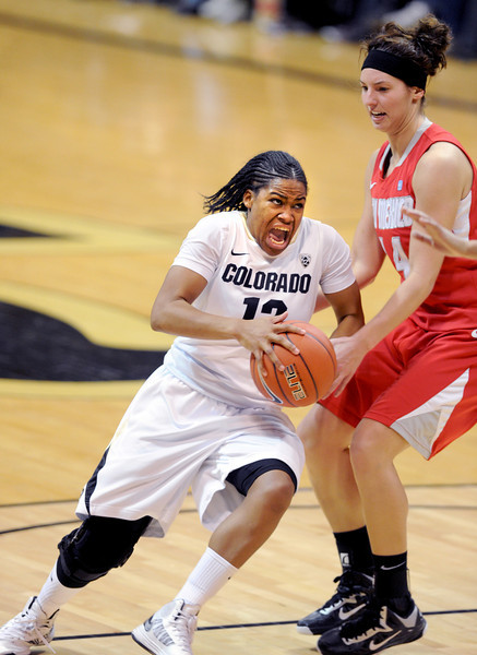 "Ashley Wilson of CU drives past Jourdan Ershine of New Mexico.<br /> For more photos of the game, go to  <a href=""http://www.dailycamera.com"">http://www.dailycamera.com</a>.<br /> Cliff Grassmick / December 29, 2012"