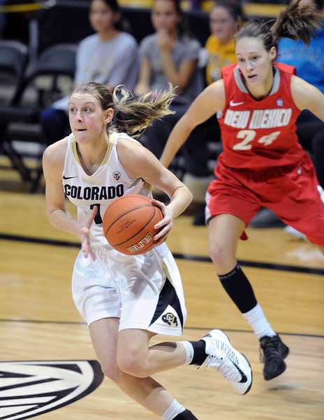 "Lexy Kresl of CU drives past Caroline Durbin of New Mexico on Saturday.<br /> For more photos of the game, go to  <a href=""http://www.dailycamera.com"">http://www.dailycamera.com</a>.<br /> Cliff Grassmick / December 29, 2012"