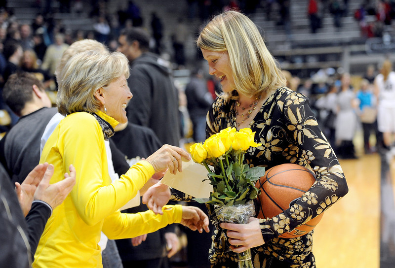"Linda Lappe, right, is congratulated by her former coach, Ceal Barry, after the game. University of Colorado coach, Linda Lappe, gets her 100th career coaching win against the University of New Mexico on Saturday.<br /> For more photos of the game, go to  <a href=""http://www.dailycamera.com"">http://www.dailycamera.com</a>.<br /> Cliff Grassmick / December 29, 2012"