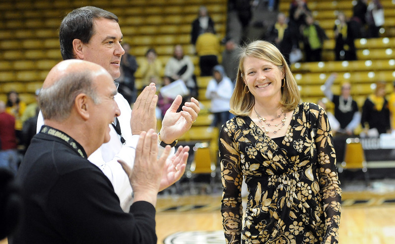 "University of Colorado coach, Linda Lappe, right, gets her 100th career coaching win against the University of New Mexico on Saturday. She is congratulated by Chancellor Phil DiStefano and AD, Mike Bohn.<br /> For more photos of the game, go to  <a href=""http://www.dailycamera.com"">http://www.dailycamera.com</a>.<br /> Cliff Grassmick / December 29, 2012"