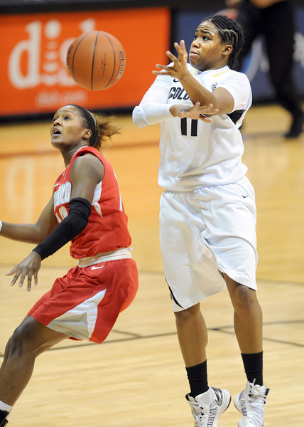 "Bryce Owens of New Mexico, knocks the ball away from Brittany Wilson during the first half of the December 29, 2012 game in Boulder.<br /> For more photos of the game, go to  <a href=""http://www.dailycamera.com"">http://www.dailycamera.com</a>.<br /> Cliff Grassmick / December 29, 2012"