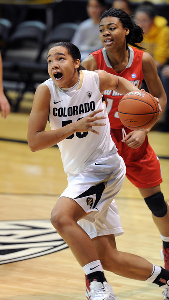 "Jamee Swan of CU drives past Bryce Owens of New Mexico on Saturday.<br /> For more photos of the game, go to  <a href=""http://www.dailycamera.com"">http://www.dailycamera.com</a>.<br /> Cliff Grassmick / December 29, 2012"