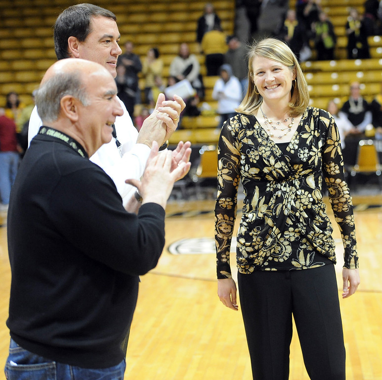 "University of Colorado coach, Linda Lappe, gets her 100th career coaching win against the University of New Mexico on Saturday. She is congratulated by Chancellor Phil DiStefano and AD, Mike Bohn.<br /> For more photos of the game, go to  <a href=""http://www.dailycamera.com"">http://www.dailycamera.com</a>.<br /> Cliff Grassmick / December 29, 2012"