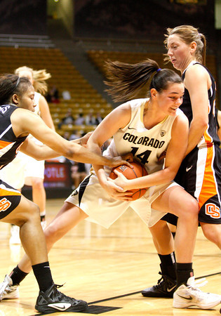 Meagan Malcolm-Peck, 14, fights for the ball during the C.U. vs. Oregon State woman's basketball game at C.U. Boulder Saturday, March, 3, 2012.