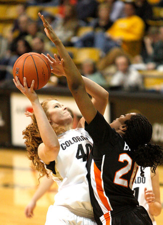 Rachel Hargis, 40, jump up for a shot as Patricia Bright, 20, reaches to block her during  C.U. vs. Oregon State woman's basketball game at C.U. Boulder Saturday, March, 3, 2012.