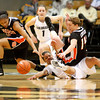 Chucky Jeffery, 23, falls to ground reaching for a loose ball as Earlysia Marchbanks, 15, recovers the ball during the C.U. vs. Oregon State woman's basketball game at C.U. Boulder Saturday, March, 3, 2012.