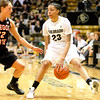 Chucky Jeffery, 23, charges down the court as Sage Indendi, 22, follows her during  C.U. vs. Oregon State woman's basketball game at C.U. Boulder Saturday, March, 3, 2012.