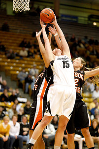 Julie Seabrook, 15,  Patricia Bright, 20, and Sage Indendi, 22, all jump up for a rebound during the C.U. vs. Oregon State woman's basketball game at C.U. Boulder Saturday, March, 3, 2012.