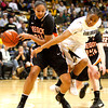 Brittany Wilson, 11, tries to steal the ball from Alyssa Martin, 24, during the C.U. vs. Oregon State woman's basketball game at C.U. Boulder Saturday, March, 3, 2012.
