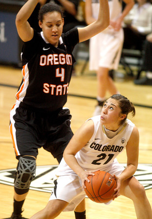 Jasmine Sborov, 21, readies to take a shot as Thais Pinto, 4, attempts to block her during  C.U. vs. Oregon State woman's basketball game at C.U. Boulder Saturday, March, 3, 2012.