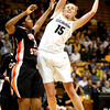 Julie Seabrook, 15, jumps for a rebound as Patricia Bright, 20, tries to stop her during the C.U. vs. Oregon State woman's basketball game at C.U. Boulder Saturday, March, 3, 2012.