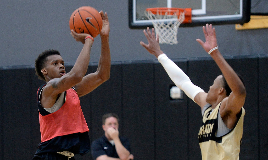 . BOULDER, CO: University of Colorado\'s  Eli Parquet, left, shoots   during the first practice for the CU men\'s team on October 2, 2018. ((Photo by Cliff Grassmick/Staff Photographer)
