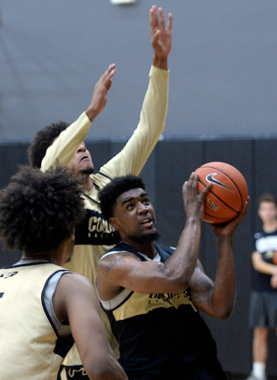 . BOULDER, CO: University of Colorado\'s  Namon Wright drives to the basket during the first practice for the CU men\'s team on October 2, 2018. ((Photo by Cliff Grassmick/Staff Photographer)