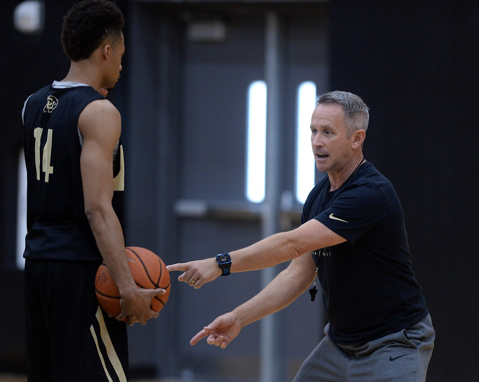 . BOULDER, CO: University of Colorado\'s Bill Grier, right,  during the first practice for the CU men\'s team on October 2, 2018. ((Photo by Cliff Grassmick/Staff Photographer)