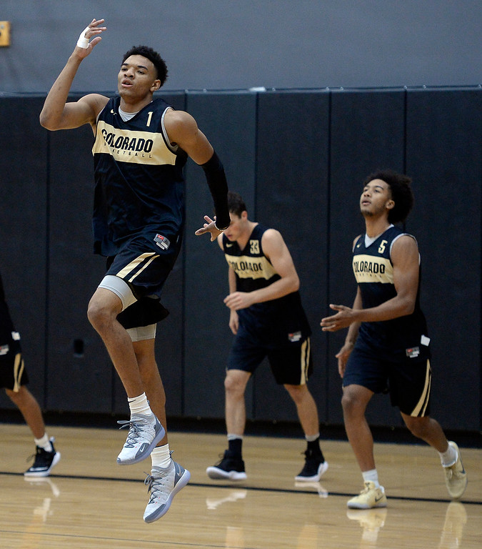 . BOULDER, CO: University of Colorado\'s  Tyler Bey, left warms up  during the first practice for the CU men\'s team on October 2, 2018. ((Photo by Cliff Grassmick/Staff Photographer)
