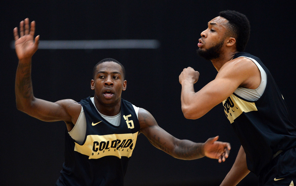 . BOULDER, CO: University of Colorado\'s  McKinley Wright IV, left, and Dallas Walton, go through defensive drills  during the first practice for the CU men\'s team on October 2, 2018. ((Photo by Cliff Grassmick/Staff Photographer)