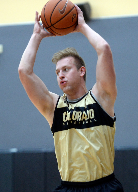 . BOULDER, CO: University of Colorado\'s  Alex Strating gets a rebound during the first practice for the CU men\'s team on October 2, 2018. ((Photo by Cliff Grassmick/Staff Photographer)