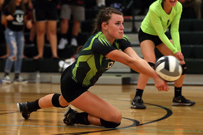 Cloverleaf senior Brooke Swain goes to the floor to play a ball during the Colts' match against Coventry. AARON JOSEFCZYK / GAZETTE