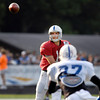 Colts quarterback Andrew Luck throws the ball to Reggie Wayne as he makes his cut.