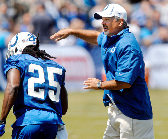 The Colts head coach Chuck Pagano gives cornerback Marshay Green a pat on  his helmet as he finished running a drill during the second day of training camp practice at Anderson University.