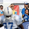 These fans keep their eyes on Reggie Wayne as he runs drills in front of them during Friday's morning practice.