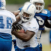 Colts running back Delone Carter gets bogged trying to run the ball through the line Monday.