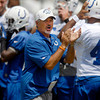 Colts head coach Chuck Pagano cheers his players on at the start of practice Monday.
