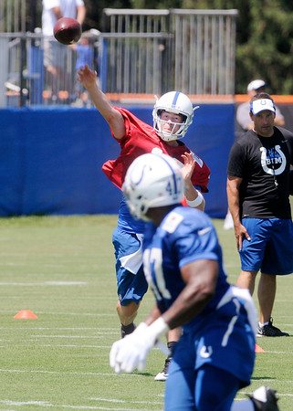 Don Knight | The Herald Bulletin<br /> Quarterback Scott Tolzien throws the ball to tight end Emil Igwenagu on the first day of Colts Camp at Anderson University on Wednesday.