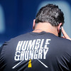 "Don Knight | The Herald Bulletin<br /> Colts General Manager Ryan Grigson wears a t-shirt with the team's slogan for camp this year ""Humble & Hungry."" Colts city is open today from 12:30 - 5 PM and open practice starts at 1:55 PM."