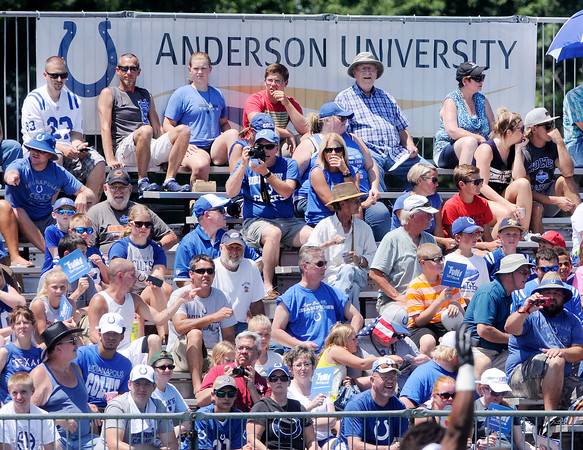 Don Knight | The Herald Bulletin<br /> Fans watch the first day of Colts Camp at Anderson University on Wednesday from bleachers installed on the west side of the practice field.