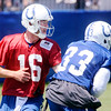 Don Knight | The Herald Bulletin<br /> Quarterback Scott Tolzien hands off the ball to running back Robert Turbin on the first day of Colts Camp at Anderson University on Wednesday.