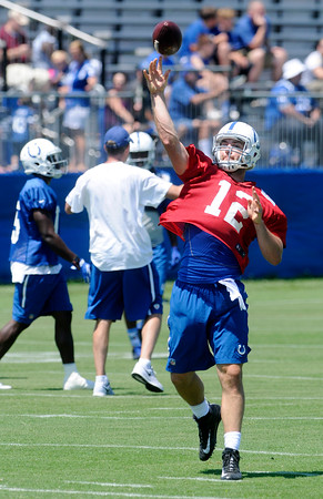 Don Knight | The Herald Bulletin<br /> Andrew Luck throws a pass on the first day of Colts Camp at Anderson University on Wednesday.