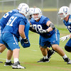 Don Knight | The Herald Bulletin<br /> Rookie center Ryan Kelly (78) runs through a drill with, from left, Kitt O'Brien, Adam Redmond, Hugh Thornton and Jack Mewhort during practice at Colts Camp at Anderson University on Thursday.