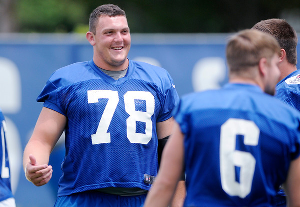 Don Knight | The Herald Bulletin<br /> Rookie center Ryan Kelly talks with his teammates as they wait for practice to start during Colts Camp at Anderson University on Thursday.